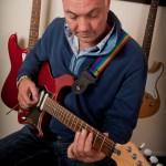 Adult guitarist