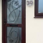 Bevelled door & house number.