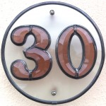 Bevelled glass house number.