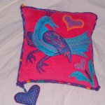Bright bird cushion