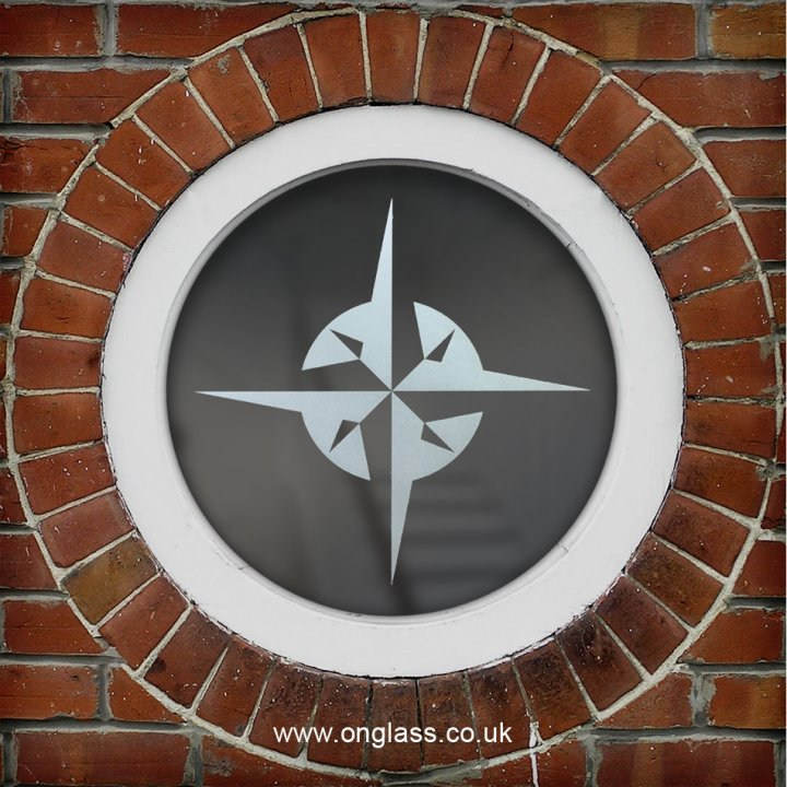 Compass rose round window