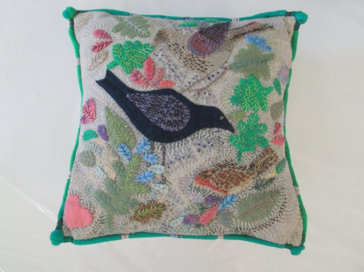 Cushion with garden birds
