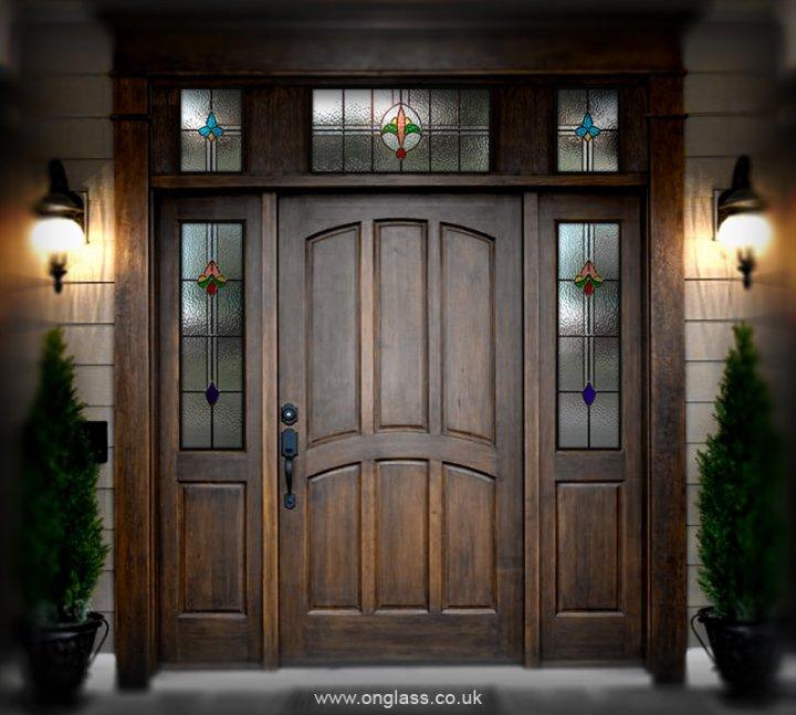 Elegant front door with stained glass.