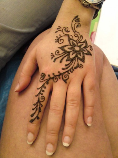 This design was piped onto the hand using henna I prepare myself  The    Easy Henna Hand Tattoos