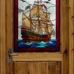 Galleon design door glass