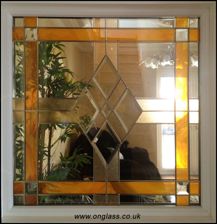 Gold lead bevel glass window.