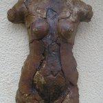 High fired female torso.