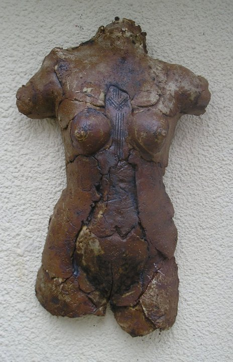 High fired female torso.