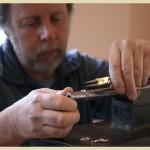Luke designing a piece of jewellery
