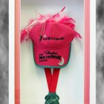 Medal and baseball cap for breast cancer charity walk