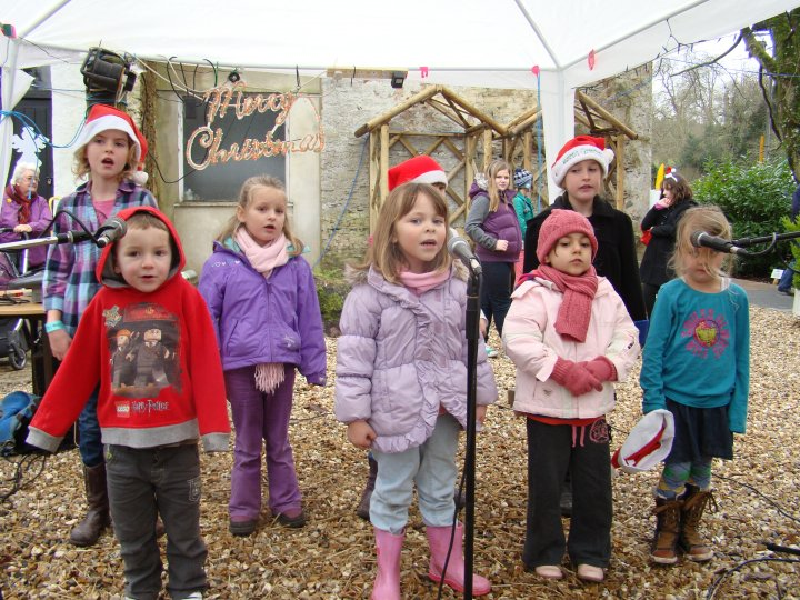 Project Performers singing at Lupton's Christmas event