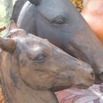 Two Matt copper horses