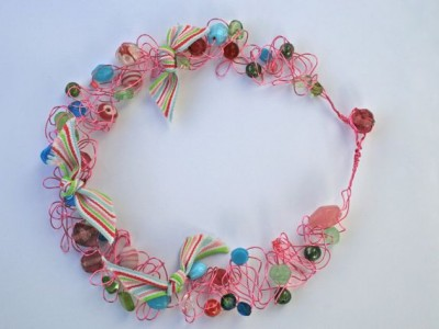 Wire work necklace with beads and ribbon