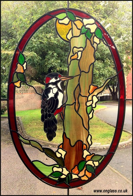 Woodpecker glass pattern window design